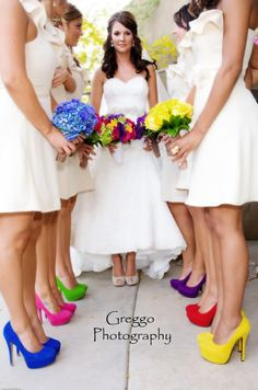 Matching white dresses, different brightly colored pumps.
