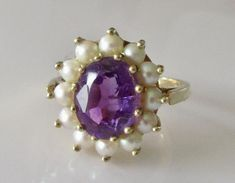 This is a beautiful vintage gold ring set with a large oval amethyst which is carats in size and twelve pearls. Pearl Jewelry, Fine Jewelry, Unique Jewelry, Engagement Rings Under 500, Vintage Rings, Vintage Jewelry, Cluster Ring, Silver Diamonds, Yellow Gold Rings