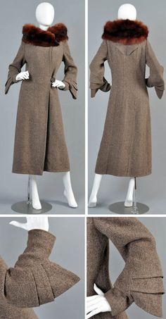 Coat, Grocott & Co, Shrewsbury, England, late 1920s/very early 30s. Fin-sleeved wool coat with dark mahogany standing collar, which crosses around collar bones. Long narrow sleeves with tiered fins below elbows. Asymmetric button closure. Top-stitched pleated details in back. Fully lined. Bustown Modern/1st Dibs