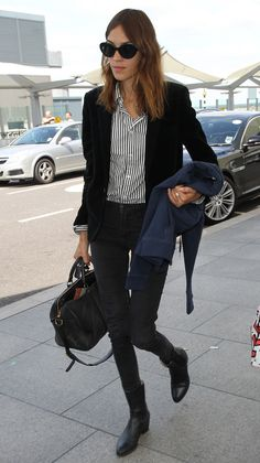 Alexa Chung looks ladylike as she channels menswear at London's Heathrow Airport. via @stylelist | http://aol.it/1tlacAb