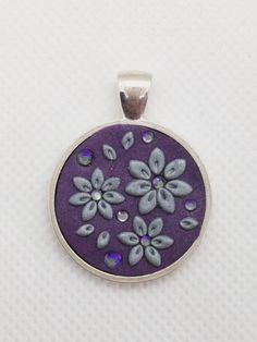 Embrodiery Applique Polymer Clay Pendant- shimmery purple- silver flowers and Swarovski crystals by NadoandLola on Etsy