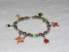 Beautiful Silver tone and Bug & Butterfly Charm stretch bracelet NA3