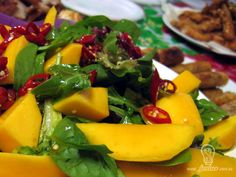 mixed salad leaves (including baby spinach, rocket, raddicchio)  and fresh mango with a honey, lemon, soy and chilli dressing