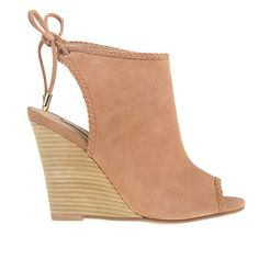 Step into the Larox wedge for instant style. This sandalized wedge bootie features braided trim accents, a flirty peep toe and tie closure at back. By Kristin Cavallari for Chinese Laundry. Leather, 3