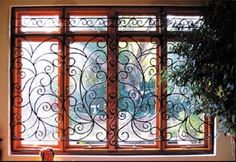 We love these iron burglar bars. We included them in an article we compiled that shows the most creative burglar bars on Pinterest: http://tinyurl.com/ofxaakd