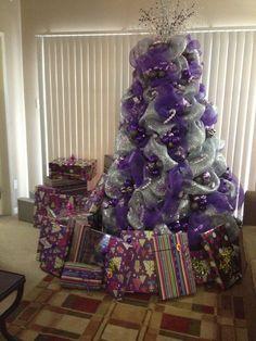 Christmas tree decorating with purple deco mesh