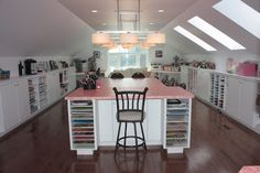 This loft craft room fits 8 crafters plus herself.
