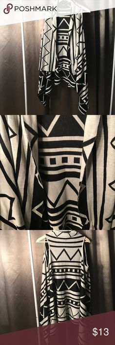 White and black tribal print sweater wrap. Large White and black tribal print sweater wrap. Perfect for layering over tanks, or long sleeved blouses! Sharbite bottom detail. Size Large Sweaters
