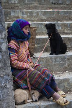 A Hmong lady is waiting at the market with her two dogs, Bac Ha market, Vietnam. For the full article, click.