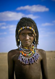 Africa | An Afar girl in Danakil, Ethiopia. | © Eric Lafforgue {Once she gets married she will cover up her hair}
