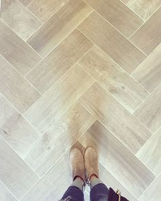 "Picking out wood-look floor tile today for a local client. We're going to do a shorter tile in a herringbone pattern for the entry (just like in this image from @greigedesign) and longer 48"" tiles for the straight lay everywhere else. I'm remembering from a post I did a month or so ago that @flooranddecor has a couple great wood tile options that have that French oak look and they're under our budget!"