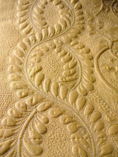 Cindy Needham - feather detail of yellow silk quilt