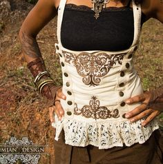 Love this little ivory lace steampunk vest with bronze buttons and detailed embroidery ~ plus all the multi-colored metallic bangles <3