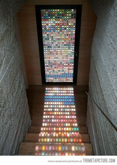 Mosaic door reflects colors onto staircase...incredible.