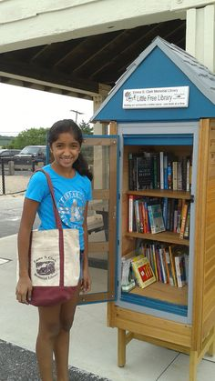 """Teen volunteer Prisha at our Little Free Library at West Meadow Beach! She's checking in to make sure it's stocked & neat this week (& sporting the """"classic"""" Emma Clark bag!)"""