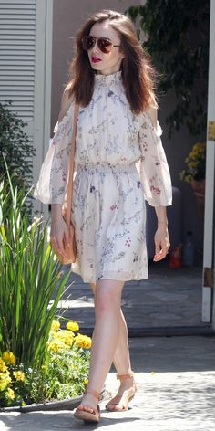 Lily Collins stepped out in Los Angeles, looking like a summer daydream. The The Last Tycoon star wore a charming cold shoulder floral dress by Rachel Zoe Collection, teamed with neutral accessories and oversized sunglasses. Lily Collins Style, Lily Collins Dress, Paris Outfits, Nice Dresses, Summer Dresses, Celebrity Look, Celebrity Photos, Celebrity News, Style Snaps