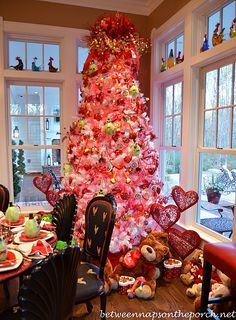 Valentine's Day Decorating Tree - I thought about doing this! All I would have to do is hit the after Christmas sales, purchase a white tree, add pink glittery heart ornaments, even red lights. Could be fun for next year.
