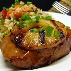 Pineapple Grilled Pork Chops Recipe - Pork chops marinate overnight in a sweet and savory Asian-inspired mixture of pineapple juice, brown sugar, and soy sauce before they're grilled and served with grilled pineapple slices. Pork Chop Recipes, Grilling Recipes, Cooking Recipes, Healthy Recipes, Barbecue Recipes, Cookbook Recipes, Shrimp Recipes, Sauce Recipes, Potato Recipes