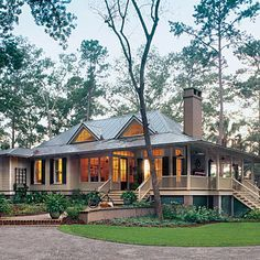 dream .... my retirement home on a nice piece of property surrounded by nature and possibly water. I love the porch, the natural light that all the windows allow in, and open floor plan of kitchen and living. Top House Plans - Southern Living