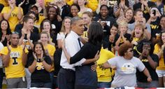 Caption: President Obama hugs first lady Michelle Obama on stage during the grassroots event at University of Iowa, Sept. in Iowa City, Iowa.