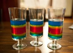 Double Rainbow Jelly Shots    (4 3 oz. boxes flavored gelatin (2 blue, 1 yellow, 1 red)  3 cups vodka  20  ice cubes  3 cups boiling water)