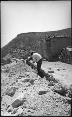 "Maria Chabot, ""Laying Foundations for the Abiquiu House Studio, Looking East,"" 1946. Contemporary photographic print, 9 5/8 x 6 1/8 in. Georgia O'Keeffe Museum. Gift of Maria Chabot. RC-2001-002-024 a. Copyright Georgia O'Keeffe Museum."