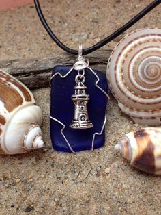347 - Lighthouse on dark blue Seaglass
