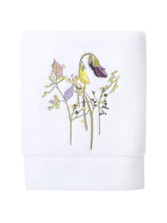A ribbon finished, underlined by a silver thread, gives a touch found in feminine fashions to the design of this beautiful bath towel.