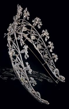 Diamond and platinum tiara, by Joseph Chaumet, circa 1908. The openwork tiara with carnation, foliate and floral bud motifs, some en tremblant, set throughout with old-cut diamonds. #Chaumet #BelleEpoque #tiara