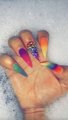 """If you're unfamiliar with nail trends and you hear the words """"coffin nails,"""" what comes to mind? It's not nails with coffins drawn on them. It's long nails with a square tip, and the look has. Neon Nails, Rainbow Nails, Dope Nails, Bling Nails, My Nails, Stiletto Nails, Coffin Nails, Almond Shape Nails, Best Acrylic Nails"""