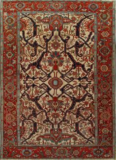 The bold split arabesque pattern overlies a dark woven angular floral vine design, all on an ecru field. The major strapwork terminates at each end of the field in striking winged palmette. There is a small central rosette positioning the overall layout, and full and half palmettes figures prominently along the central axis and on […]