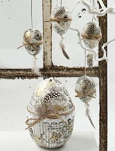 These Easter eggs are decorated with real feathers, rustic twine and black/white graphics.
