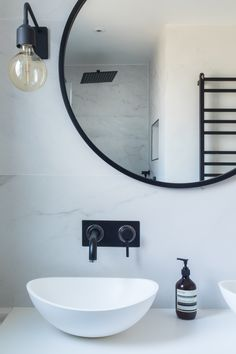 Bathroom, marble tiles, marble, black and white bathroom, industrial luxe, industrial bathroom, black taps, black fittings, resin sink, black mirror, round mirror, black wall lights