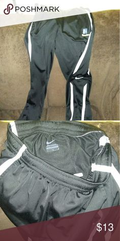 Nike athletic pants Nike Black athletic pants with white stripes perfect condition with strings. Nike Pants Sweatpants & Joggers