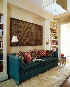 Peacock blue sofa and shaggy cream carpet
