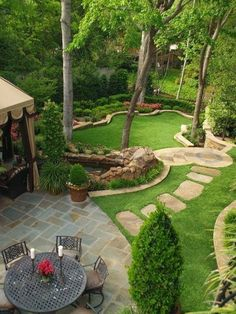 Make a yard smaller and more interesting with deep side beds and curves.