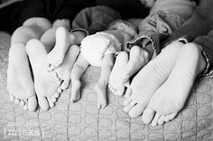 "Love it! When I told my husband we were expecting this past baby, I wrapped up a pair of baby socks with a note that said something to the effect of ""Our family is growing by 2 feet"". We so need a picture like this!"