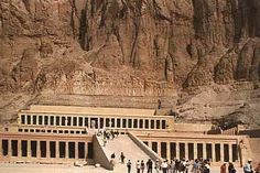 """The Mortuary Temple of Queen Hatshepsut, the Djeser-Djeseru (""""Holy of Holies""""), is located beneath the cliffs at Deir el Bahari on the west bank of the Nile near the Valley of the Kings in Egypt. The mortuary temple is dedicated to the sun god Amon-Ra and is located next to the mortuary temple of Mentuhotep II, which served both as an inspiration, and later, a quarry. It is considered one of the """"incomparable monuments of ancient Egypt."""""""