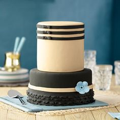 This cake is dressed to the nines, with neat fondant bows, a scalloped border and a simple blue boutonniere. Create the black, sand and blue colors while retaining the light vanilla flavor of Decorator Preferred Fondant using the Wilton's Color Right™ Performance Color System.