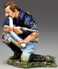Custer's Last Stand TRW027 Trooper Applying First Aid - Made by King and Country Military Miniatures and Models. Factory made, hand assembled, painted and boxed in a padded decorative box. Excellent gift for the enthusiast.