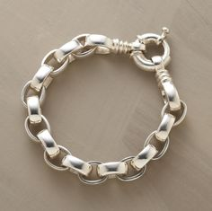 """Forged by hand from thick, weighty sterling silver, our classic link bracelet has both power and polish. The bold ring closure adds distinctive design presence. 8""""L."""