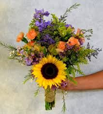 Bride's bouquet of sunflowers, lavender stock, solidaster, caspia, peach mini carnations waxflower and yellow alstroemeria. Daisy Wedding Flowers, Rustic Wedding Flowers, Bridesmaid Flowers, Wedding Bouquets, Sunflower Weddings, Wild Flower Arrangements, Wedding Arrangements, Flower Centerpieces, Bouquet Champetre