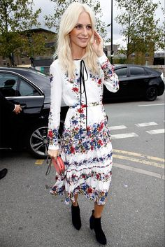 Poppy Delevingne wears a floral white midi dress with black suede boots