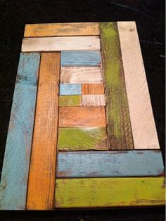 art from repurposed wooden pallets. Have a larger one in my house but like this layout/size.