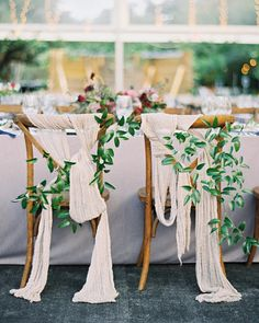 A Gem-Toned Texas Wedding with French Touches | Martha Stewart Weddings - The same gauzy open-weave linen on the tables was used to decorate the backs of the couple's chairs.
