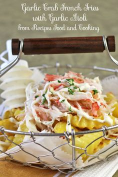 Garlic Crab French Fries are made with baked french fries, garlic butter bath and topped with crab and garlic aioli.