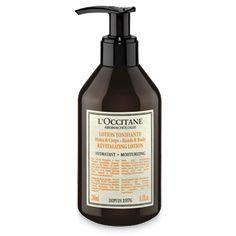 Bottle of Aromachologie Revitalizing Lotion for Hands & Body moisturizes & hydrates for softer skin.