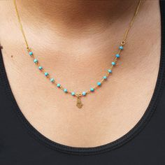 Petite Hamsa hand hangs delicately on a gold chain embellished with turquoise beads. Can be worn alone or layered, simply the cutest little Hamsa necklace.   #backtoschool #little #petite #hamsa #cute #hamsanecklace #etsy #shop #fashion #style #jewelry #turquoise #simple #beautiful