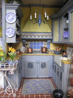 Susan's Miniatures. French kitchen. Note shabby blue paint. Not sure if tiles are simply pictures. Interesting blue wood chandelier. Copyright Shutterfly, you can purchase images of her work, even make a book of an album.