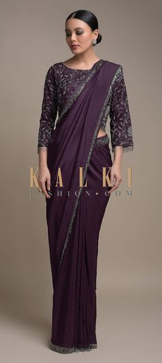 Buy Online from the link below. We ship worldwide (Free Shipping over US$100)  Click Anywhere to Tag Eggplant Purple Saree In Silk Blend Trimmed With Cut Dana Fringes On The Border Online - Kalki Fashion Eggplant purple saree in silk blend trimmed with cut dana fringes on the border.Paired with a matching blouse in raw silk.Heavily embellished with cut dana and beads in jaal pattern.